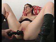Partner using a black dildo on my wet slippery cunt