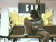 Naughty mature lady playing with her cunt at the shopping mall