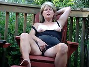 Heather ouside on the deck getting herself off in front of me