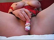 Amateur with big juggs masturbating in the bedroom
