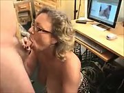 Nerdy mature slut with massive tits sucking a hard cock
