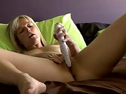 Blonde beauty toys her cunt in bed