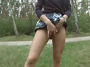 Horny couple fooling around masturbating in a public park