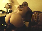 Fucking her from behind while bent over chair