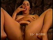 Holly spreads her legs and fingers hairy pussy and licks fingers