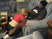 Lovely blonde cougar pleases a muscle black guy in bed