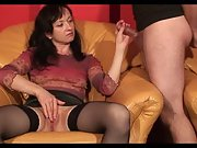 Mature lady gives a gentle handjob to a horny stud
