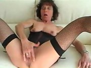Slutty mature mistress sucks a hard dick and masturbates
