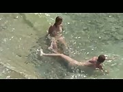 Voyeur porn couple filmed having sex in the sea on a pebble beach