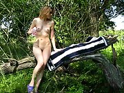 Girlfriend stripping off and sitting on a tree naked in public