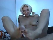 Pigtailed blonde giving a footjob and handjob