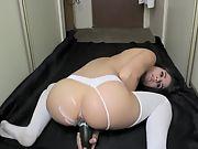 Lovely brunette camgirl masturbates in the corridor