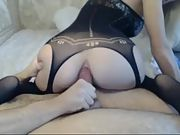 Hottie in sexy lingerie rides her holes on a fat cock