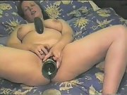 A wine bottle and a cucumber bring on an orgasm